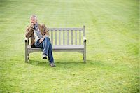 Man sitting on a bench and thinking in a park Stock Photo - Premium Royalty-Freenull, Code: 6108-06167139