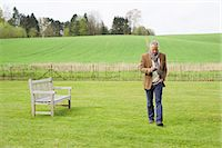 farm phone - Man using a mobile phone in a field Stock Photo - Premium Royalty-Freenull, Code: 6108-06167145