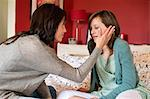 Woman consoling her sad daughter in the bedroom Stock Photo - Premium Royalty-Free, Artist: Kathleen Finlay, Code: 6108-06167207