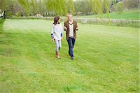 Man discussing with his daughter during walk in a park Stock Photo - Premium Royalty-Freenull, Code: 6108-06167250