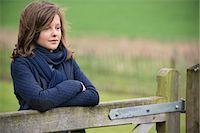 preteen beauty - Girl thinking in a farm Stock Photo - Premium Royalty-Freenull, Code: 6108-06167265