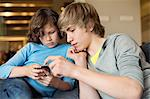 Teenage boy with his brother using a cellphone Stock Photo - Premium Royalty-Free, Artist: Jose Luis Stephens, Code: 6108-06167273