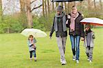 Family walking with umbrellas in a park Stock Photo - Premium Royalty-Free, Artist: Jean-Yves Bruel, Code: 6108-06167366