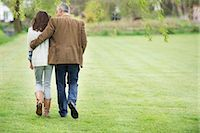 Man walking with his daughter in a park Stock Photo - Premium Royalty-Freenull, Code: 6108-06167390