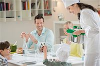 Little boy assisting his mother in serving dinner Stock Photo - Premium Royalty-Freenull, Code: 6108-06167402