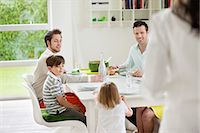 Happy family at dining table Stock Photo - Premium Royalty-Freenull, Code: 6108-06167420