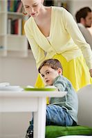Woman with her son at a dining table Stock Photo - Premium Royalty-Freenull, Code: 6108-06167447