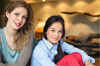 Portrait of a woman smiling with her daughter Stock Photo - Premium Royalty-Freenull, Code: 6108-06167475