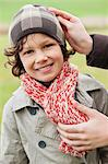 Woman putting on warm clothing on her son Stock Photo - Premium Royalty-Free, Artist: urbanlip.com, Code: 6108-06167543