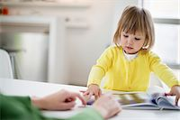 Woman teaching her daughter at home Stock Photo - Premium Royalty-Freenull, Code: 6108-06167588
