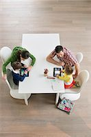 High angle view of couple teaching their children Stock Photo - Pre