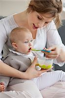 Woman feeding her daughter Stock Photo - Premium Royalty-Freenull, Code: 6108-06167712