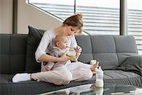 Woman feeding her daughter Stock Photo - Premium Royalty-Freenull, Code: 6108-06167717