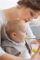 Woman feeding her daughter Stock Photo - Premium Royalty-Freenull, Code: 6108-06167734