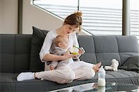 Woman feeding her daughter Stock Photo - Premium Royalty-Freenull, Code: 6108-06167742