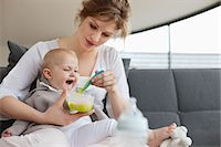 Woman feeding her daughter Stock Photo - Premium Royalty-Freenull, Code: 6108-06167752