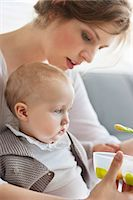 Woman feeding her daughter Stock Photo - Premium Royalty-Freenull, Code: 6108-06167769