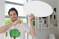 Man holding a speech bubble Stock Photo - Premium Royalty-Freenull, Code: 6108-06167854