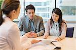 Business executive discussing with her clients Stock Photo - Premium Royalty-Free, Artist: Westend61, Code: 6108-06167921