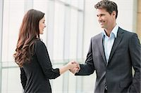 Business executives shaking hands in an office Stock Photo - Premium Royalty-Freenull, Code: 6108-06167955