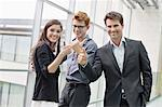 Business executives showing thumbs up and smiling in an office Stock Photo - Premium Royalty-Free, Artist: Blend Images, Code: 6108-06168155