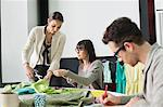 Fashion designers working in an office Stock Photo - Premium Royalty-Free, Artist: Cultura RM, Code: 6108-06168219