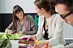 Fashion designers working in an office Stock Photo - Premium Royalty-Free, Artist: AWL Images, Code: 6108-06168225