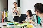 Fashion designers working in an office Stock Photo - Premium Royalty-Free, Artist: Blend Images, Code: 6108-06168227