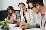 Fashion designers working in an office Stock Photo - Premium Royalty-Free, Artist: Cultura RM, Code: 6108-06168233