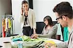 Fashion designers working in an office Stock Photo - Premium Royalty-Free, Artist: Cultura RM, Code: 6108-06168237