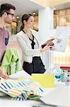 Fashion designers working in an office Stock Photo - Premium Royalty-Free, Artist: Cultura RM, Code: 6108-06168243
