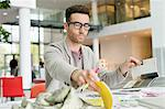 Male fashion designer working in an office Stock Photo - Premium Royalty-Free, Artist: CulturaRM, Code: 6108-06168252