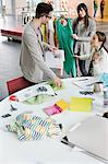 Fashion designers working in an office Stock Photo - Premium Royalty-Free, Artist: Cultura RM, Code: 6108-06168261