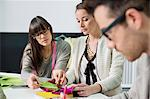 Fashion designers working in an office Stock Photo - Premium Royalty-Free, Artist: Ascent Xmedia, Code: 6108-06168270