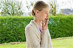 Woman smoking cigarette in park Stock Photo - Premium Royalty-Free, Artist: Jose Luis Stephens, Code: 6108-06168390