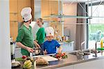 Family cooking in the kitchen Stock Photo - Premium Royalty-Free, Artist: Glowimages, Code: 6108-06168393