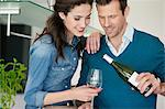 Couple drinking wine in the kitchen Stock Photo - Premium Royalty-Free, Artist: Susan Findlay, Code: 6108-06168422