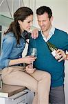 Couple drinking wine in the kitchen Stock Photo - Premium Royalty-Free, Artist: Jean-Christophe Riou, Code: 6108-06168423