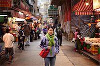 Portrait of woman in market, hong kong, china Stock Photo - Premium Royalty-Freenull, Code: 614-06168781