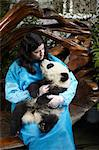 Woman holding 6 month old Giant Panda at Chengdu Panda Breeding Research Center Stock Photo - Premium Royalty-Free, Artist: Andrew Douglas, Code: 614-06168785
