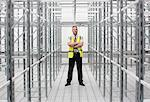 Man with arms folded in empty warehouse, portrait Stock Photo - Premium Royalty-Free, Artist: Blend Images, Code: 614-06168815
