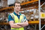 Man with arms folded in warehouse, portrait Stock Photo - Premium Royalty-Free, Artist: Glowimages, Code: 614-06168833