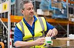 Man on tea break in warehouse Stock Photo - Premium Royalty-Free, Artist: Cultura RM, Code: 614-06168839
