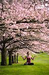 Woman in lotus position under cherry tree Stock Photo - Premium Royalty-Free, Artist: Frank Krahmer, Code: 614-06168935