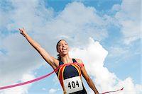 finish line - Female athlete crossing the finish line Stock Photo - Premium Royalty-Freenull, Code: 614-06168937