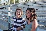 Teenage couple sitting on bleachers Stock Photo - Premium Royalty-Free, Artist: Cultura RM, Code: 614-06169085