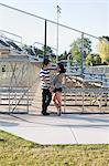 Teenage couple standing by bleachers Stock Photo - Premium Royalty-Free, Artist: Aflo Sport, Code: 614-06169091