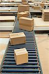 Cardboard boxes on conveyor belt Stock Photo - Premium Royalty-Free, Artist: CulturaRM, Code: 614-06169107