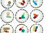 Pills in dispenser cups Stock Photo - Premium Royalty-Free, Artist: Amy Whitt, Code: 614-06169236