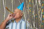 Senior man with party blower and streamers Stock Photo - Premium Royalty-Free, Artist: Beanstock Images, Code: 614-06169307